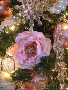 I love decorating with soft pink roses all year long; especially at Christmas with all the greenery of the pine tree...adds a touch of Victorian to our home.
