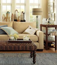 I like this room.  The COLOR CHOICES, PATTERNS and TEXTURES.  (Do NOT like the coffee table choice).