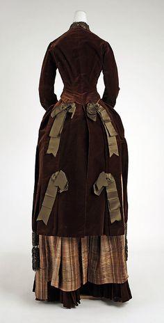 "Silk velvet dress and gored skirt of silk velvet and striped silk (back), French, 1881-83. Label: ""Merlot Larcheveque, 23 Boule. des Capucines, Paris."""