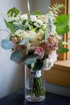 June bouquet with roses, stock, astilbe, eucalyptus, lambs ear and more. Photo by Urban Anchor Photography.