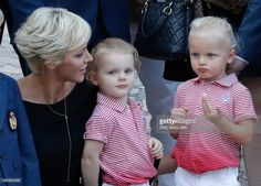 Princess Charlene of Monaco and her twins Prince Jacques (R) and Princess Gabriella take part in the traditional Monaco's picnic in Monaco, on September 1, 2017. /