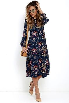 Spend a little time in your backyard harvesting snapdragons and sweet peas with the I. Madeline Garden Splendor Navy Blue Floral Print Dress! Gauzy, navy blue fabric (with a cheery floral print) shapes a darted bodice with long sleeves and button cuffs. Skirt falls from an empire waist into a modest midi-length. Back keyhole with top button closure. Hidden back zipper.
