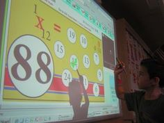 SMART BOARD - Tables of Multiplication    Students race to answer the multiplication facts. The color system lets them know when they're ready to move on to the next level.