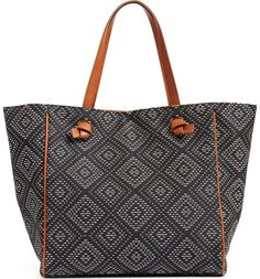 Knotted faux-leather handles top this roomy geo-woven tote that's great for everything from your daily commute to beach getaways.
