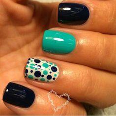 Black and blue polka dot nails.