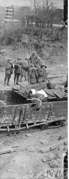 WWI, 29 April 1917, Battle of Arras; Medics of the Royal Army Medical Corps placing wounded soldiers on a light railway, near Feuchy. Detail. ©IWM  Q 6225
