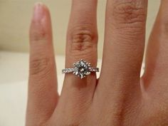 Round solitaire diamond engagement ring. With diamond paved band and a 6 prong head. perfect.