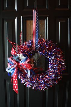 This red, white, and blue #wreath is made from a styrofoam wreath and a few craft supplies! | From Annie of Behind Our Front Door