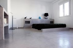 Dormitorio de micro cemento