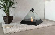 Modern Fireplace Mimics the Louvre's Iconic Glass Pyramid