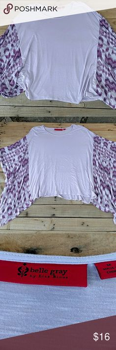 Purple and lavander poncho top by Belle Gray Unique lavender top with purple and lavender print sleeves. Flowy and comfortable. Pair with leggings or jeans Belle Gray by Lisa Rinna Tops Tees - Long Sleeve