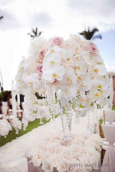 Karen Tran Florals....Maui wedding...love orchids and roses together...my favorites. ♥