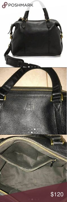 """m o n o g r a m e d . g l a s g o w Price is Firm on this listing.  Gently used. Only defects are the monogram of """"AED"""" on one side of the bag and  a missing left bolt. I have looped thread in missing bolt to keep it's shape. It's worked perfectly.  Leather. Please note: As it is made of a natural material, each bag varies slightly in texture and color. Zip closure. Interior pocket. 19 1/2"""" shoulder strap. 4 3/4"""" handle drop. 9""""H x 13 2/5""""W x 6""""D. Madewell Bags"""
