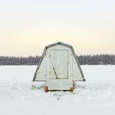 Ice fishing huts by Richard Johnson