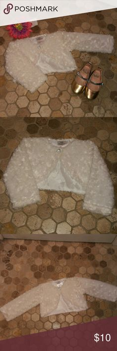 PERFECT FOR EASTER!! Beautiful Shrug Faux Fur Shrug with a beautiful swirl rose like pattern...long sleeve with Diamond rhinestone button closure ...totally adorable..looks stunning over dresses Kid Fashion Dresses