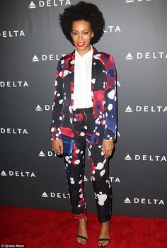 Solange Knowles cuts a colourful figure in patterned trouser suit for industry party | Mail Online