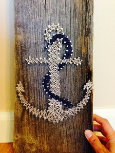 Hey, I found this really awesome Etsy listing at https://www.etsy.com/listing/192020201/nautical-string-art-anchor-rope-rustic