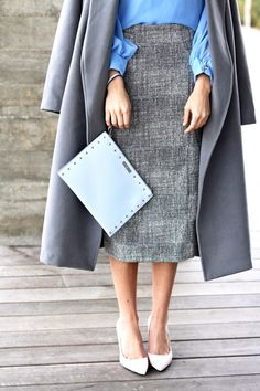 Light Grey Pencil Skirt. Cool Tone Colors with Pastel Tone Colors. Grey Trench Coat. Baby Blue Blouse. Light Pink Pumps. Light Grey Pencil Skirt. Light Blue Clutch. Work Wear. Sophisticated Style. Office Outfits.