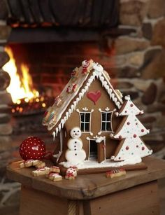 Lovely, simple gingerbread house. I love the small cookies decorated like candies and used as decorations on the roof!
