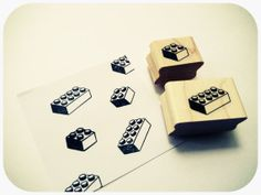Lego rubber stamp for the guestbook. Guests stamp the lego and sign. Would need to find a cool print to do this on.