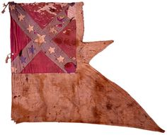 Brigadier General Bradley T. Johnson's     Headquarters Guidon. On August 7, 1864, at Moorefield, West Va, Brig General William Averell's Second Cav Div, Dept of West Va, captured Johnson's headquarters guidon. Averell's command included the 1st Regt Cav, N Y Vol. The canton, appliqued onto the front and back, is wool with cotton stars. The field is cotton and heavily soiled and stained. Approximately 25% of the flag is missing including the upper fly quadrant and several stars on both sides.