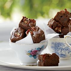 Kat Kinsman tops her rich brownies with bacon and pecans. To enhance the smoky flavor, she mixes some of the bacon fat into the batter.     Sweet ...