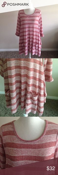 """Red stripe pocket tunic Striped two toned light red tunic. 3/4 rolled sleeves. Two front pockets. Stretchy and flowy. Hangs loosely. Approx measurements are Length 30"""" Bust 19 1/2"""" Boutique Tops Tunics"""