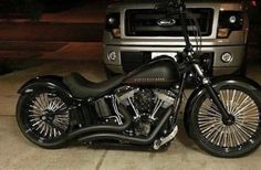 Blacked out Harley Softail with Fat Spoke wheels. Great looking bike.