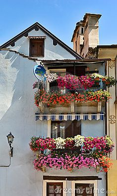 Italian house with balconies full of colorful flowers. Love the way they do these over there! Mom and I saw them on our trip over there. Never will forget!