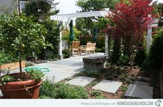 The Japanese maple tree in this backyard adds an Asian touch to it as well as the white pergola with fabric covering.