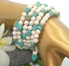 Very pretty combination of turquoise heishi beads with white magnesite turquoise beads, strung on memory wire, so the bangles hold their shape. Memory wire bracelet fits 6 - 7.5 wrist. Nice southwest look to it and can be worn for every day or for more formal occasions. Makes a lovely gift and comes gift boxed.  ♥~~~~~~~~~~~~~~~~~~~~~~~ ♥ Legal Junk ♥ ~~~~~~~~~~~~~~~~~~~~~~~~♥ ♥ All photo's are subject to US Copyright Laws.  ♥~~~~~~~~~~~~~ ♥ VISIT OUR OTHER ETSY SHOPS ♥ ~~~~~~~~~~~~♥ ♥…