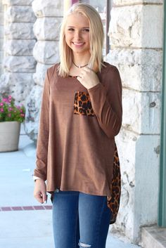 We have a soft spot for leopard and this top hits it! Suede front in mocha with leopard trim and pocket and a fully leopard print back! So cute, so comfy, and a must have for fall. Long sleeve