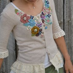 Dress up a plain sweater with felted and ribbon flowers. Add lace trim to the shortened sleeves and flounce bottom.