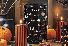 Spooky Eyes Hurricane - Ghoulish glances glow red when lit with a pillar #candle or tealight tree, not included. Sprayed-black glass sleeve with metal base. #PartyLite