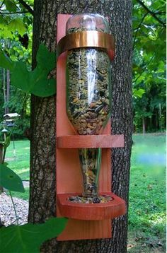 Recycled beer bottle bird feeder