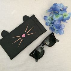 Cat sunglasses case Black sunglasses case with cat ears and whiskers. Super cute black and white stripes inside. Accessories Sunglasses