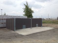 Garbage enclosure with cladding to match building