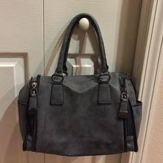 Nicole Miller gunmetal handbag, never carried Nicole Miller gunmetal handbag, never carried! Leopard print on the inside! Comes with crossbody strap. No trades! Nicole Miller Bags Satchels