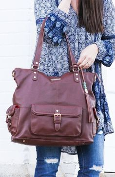 Ahhh... the beautiful Meggan from Lily Jade. She is one of our biggest bags, and store everything you might need for a day out with your littles. She features over 16 (!!) pockets to keep you organized, and can be worn as a backpack to keep your hands fre
