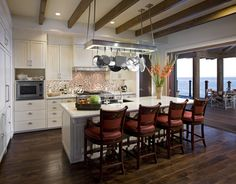 Open Concept Kitchen Layouts open concept kitchen with colorful backsplash. | young