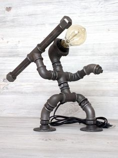 Industrial pipe table lamp Robot with the spear / Steampunk Industrial Pipe, Industrial Lighting, Pvc Furniture, Pvc Pipe Crafts, Pipe Decor, Pipe Lighting, Metal Welding, Desk Light, Pipe Lamp