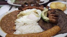 Bandeja paisa is a traditional Colombian dish that consists of beans, beef, chorizo, fried egg, fried plantain, pork rind, rice and avocado. Hatoviejo's rendition has won a devoted following.
