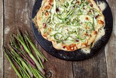 Bacon, garlic and a tangle of shaved home-grown asparagus makes this pizza a South Dakota spring and summertime delight. Recipe by Fran Hill.