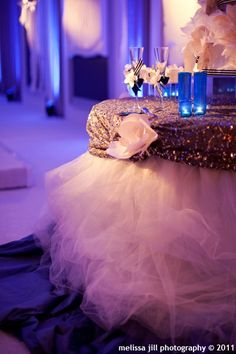 Tulle table skirt along with the other details make this cake table stand out and look so fancy!