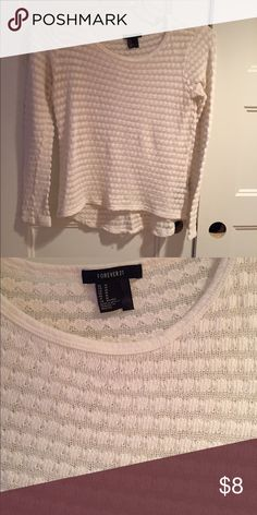 Forever 21 sweater Used in good condition! .. other than small hole in back of left arm as seen in picture. And Light stain on top by neck as seen in picture  •Color is an off white •40% Polyester, 38% Cotton 20% Rayon 2% Spandex  ⚜️NO TRADES ⚜️OFFERS WELCOMED! ⚜️BUNDLE TO SAVE ⚜️FEEL FREE TO ASK ANY QUESTIONS! Forever 21 Sweaters