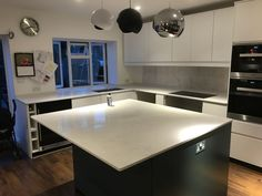 Kitchen of the week… Located in Reigate, Surrey, showcasing the Attica White Carrera - Rock and Co Granite Ltd Marble Quartz, White Quartz, White Marble, L Shaped Kitchen, Marble Effect, Window Sill, Carrara, Surrey, Granite