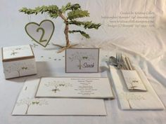 """""""Family tree""""  Features invitation with handmade envelope, stamped napkin, cutlery pocket, place card, cake box, and centrepiece tree with heart table scatters.  Available in a range of colours to suit your theme from Paper Pineapple www.facebook.com/Paperpineapple"""