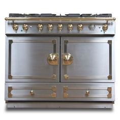 La Cornue CornuFé Stove in stainless steel with satin chrome and polished brass fixtures! Yes please.