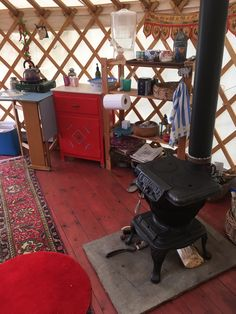 Inside the Yurt with insulated secondary floor and a fab pot bellied 1950's stove from New Zealand Building Structure, Stove, Buildings, Flooring, Range, Wood Flooring, Hearth Pad, Kitchen, Kitchen Stove