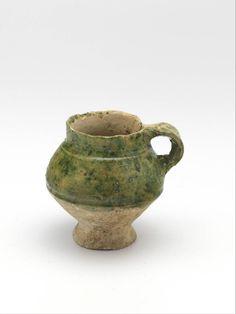 cup 1325 - 1375 Dimensions h. 7.5 x diam. 4.8 cm Material and technique lead glaze, whiteware, copper oxide